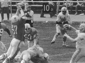 The Patriots Bull (1970) tackles Tucker Friedrickson of the New York Giants (left), blocking a pass from the Redskins' Sonny Jourgenson (right).