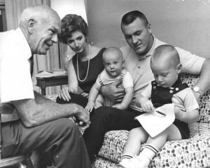 Bramlett family during St. Louis Cardinals contract signing. Cardinal scout Buddy Lewis on left (1963).