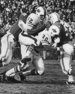 Making a head on tackle on OJ Simpson (1970). Later OJ would write in his book that Bull was a dirty player. Bull denies that.